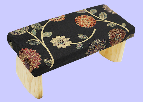 meditation bench with brown background wiht gold, red and green flowers