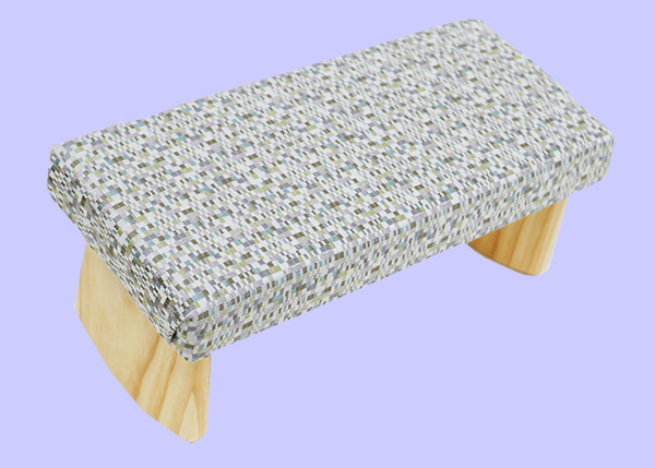 meditation bench with beige, lilac and green small squares